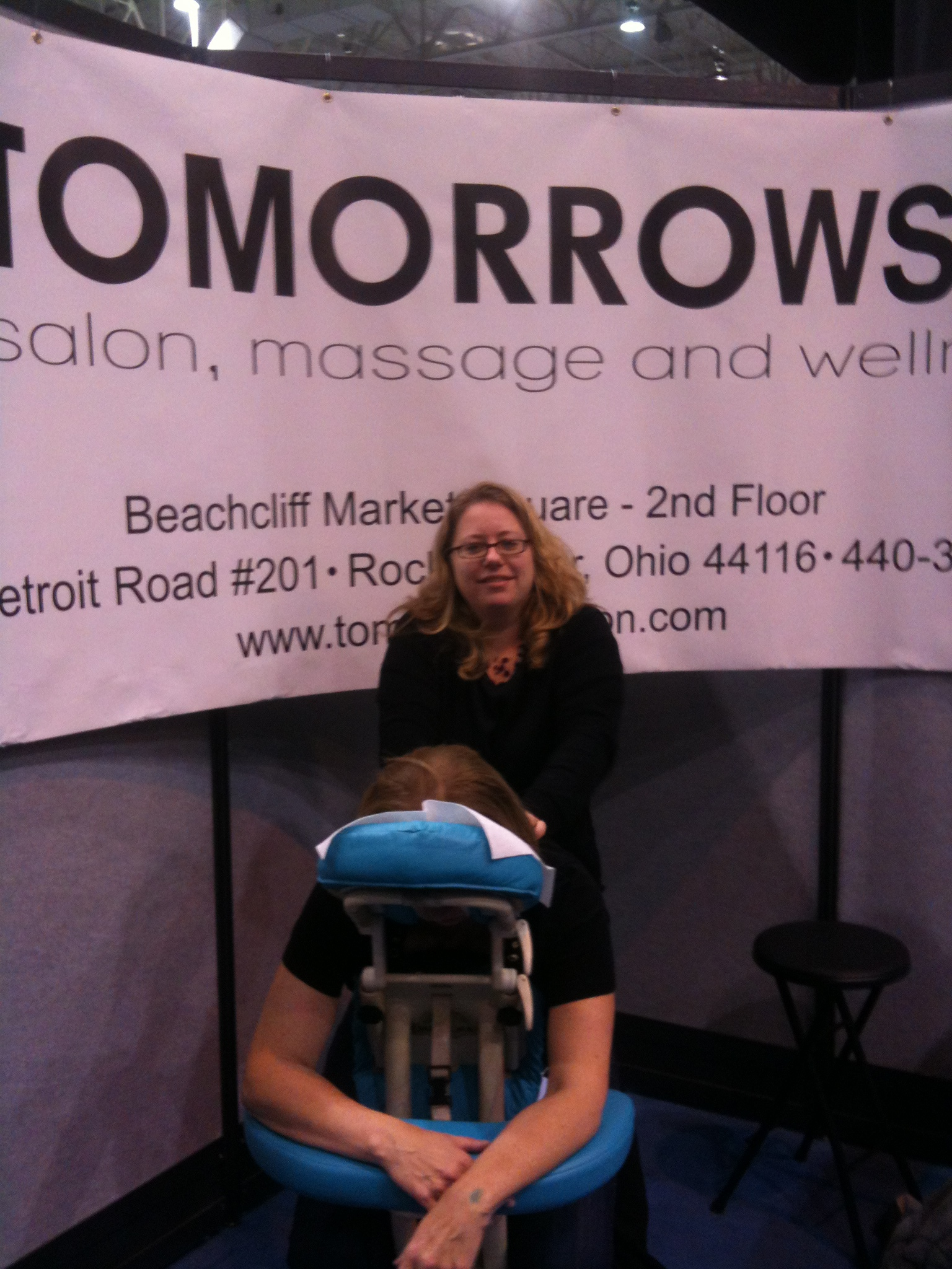 Desi performing a chair massage at the 2013 Fabulous Food show.