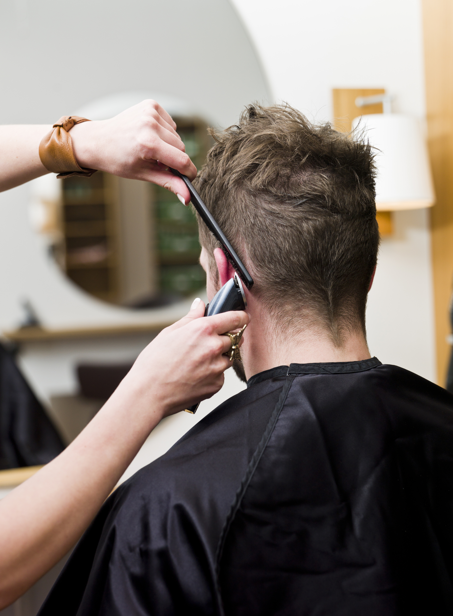 Men's cuts and color by Nadene complement facial features and hair texture.