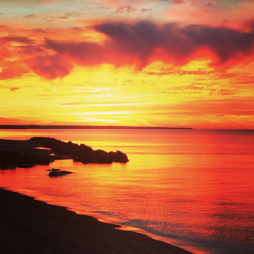 Warm hues of the sunset over Lake Erie inspirehair color choices at TOMORROWS.