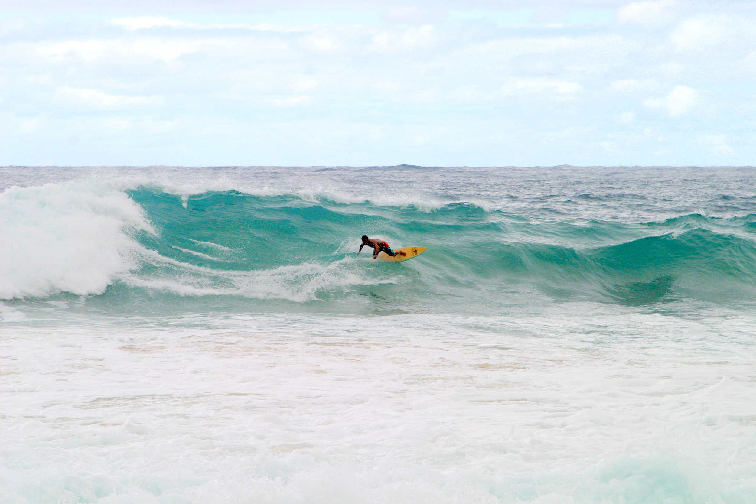 Surfer in Maniniholo Bay, Kauai