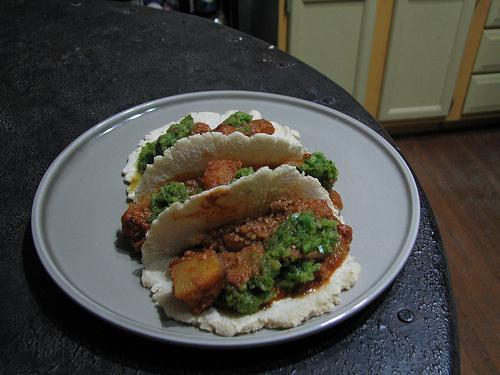 potatoes en pipian rojo tacos.jpg