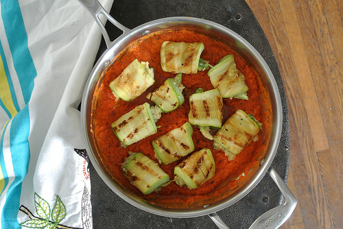 zuchinni rollatini with red pepper sauce table.jpg