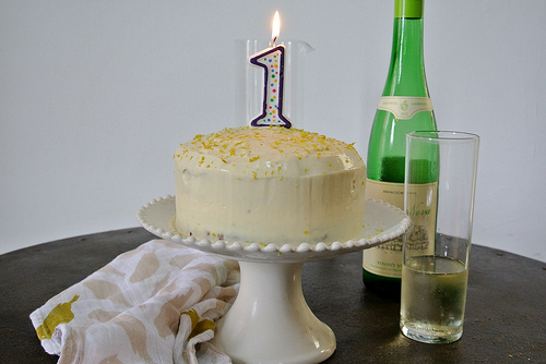 chocolate layer cake with mimosa creamsicle table with candle.jpg
