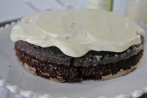 chocolate layer cake with mimosa creamsicle frosting first layer frosted.jpg