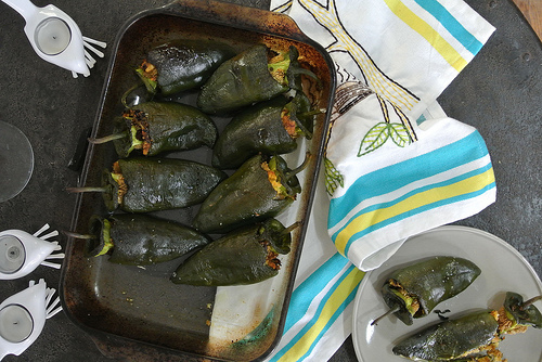 oaxacan cornbread-stuffed roasted poblanos table.jpg