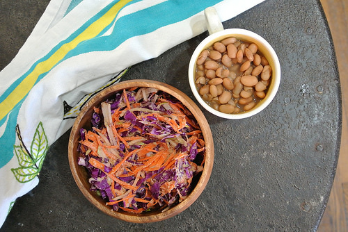 smoky pinto beans + red cabbage-carrot-pear slaw with creamy mustard-orange-walnut dressing table.jpg