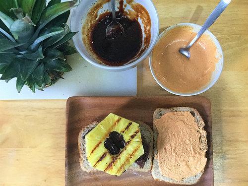bbq tofu-pecan loaf sandwich with pineapple and smoky tahini sauce table.jpg