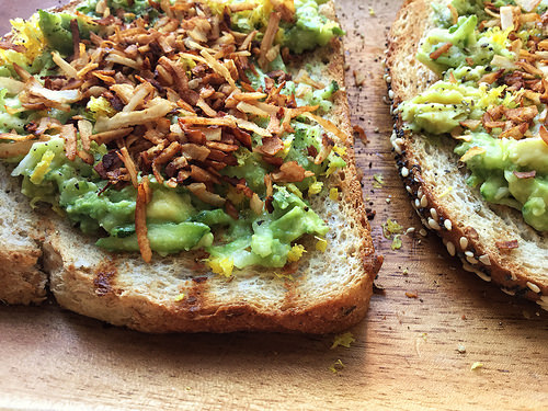 dead simple zucchini toast with avocado, lemin zest, and coconut bacon detail.jpg