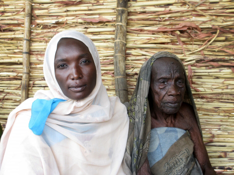 """A grandmother and granddaughter living in Treguine refugee camp. """"I get up early to get the water and make food for my grandmother, then I go to the farm,"""" the granddaughter said. """"There's no one else to take care of her."""""""
