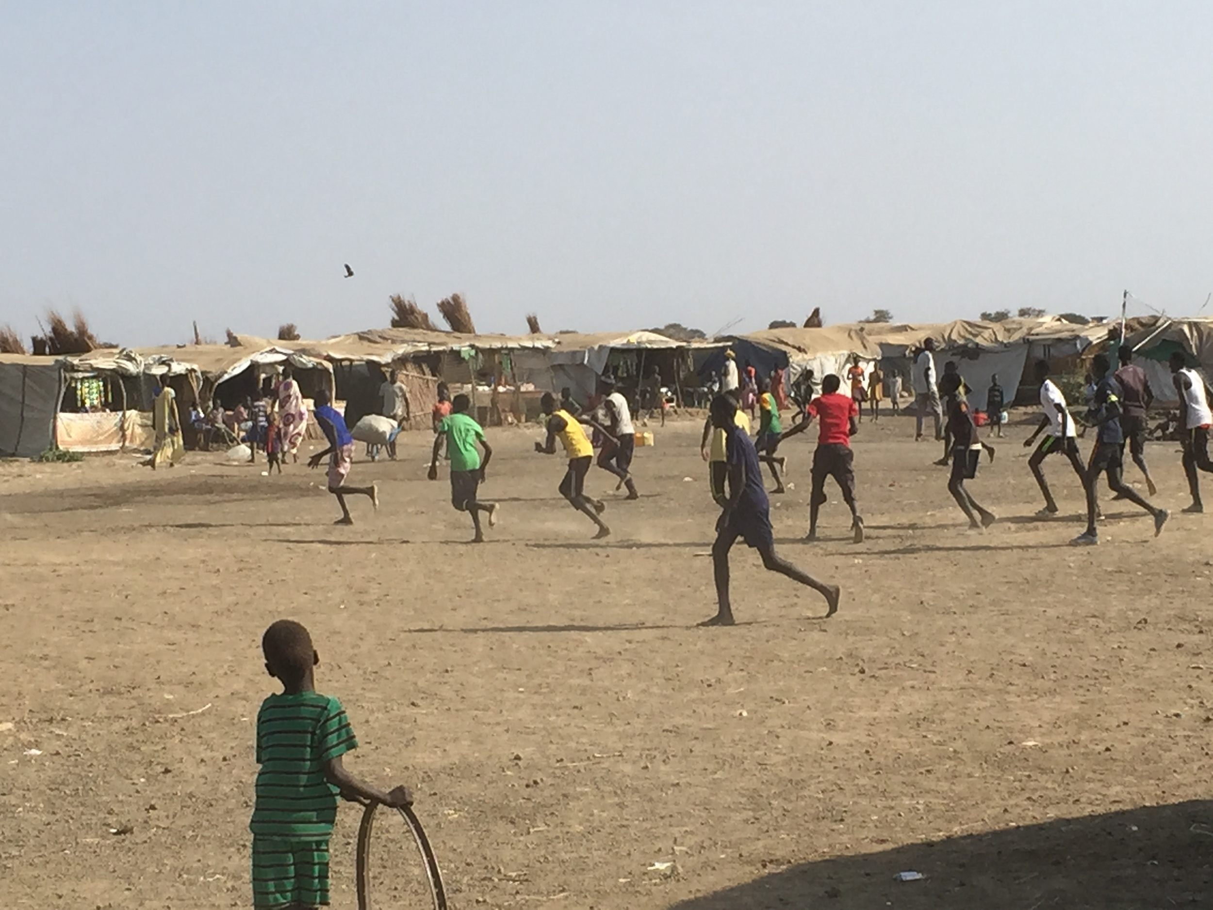 Boys play soccer in one of the camp's open spaces. Safe recreational ares are critical for this population, which has experienced severe trauma.