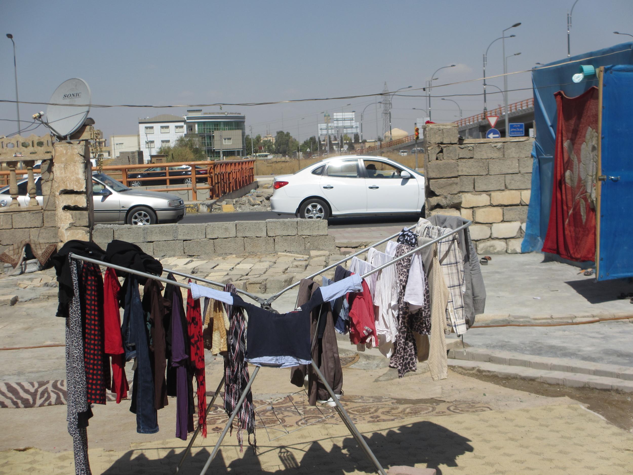 Syrian refugee family, laundry.JPG