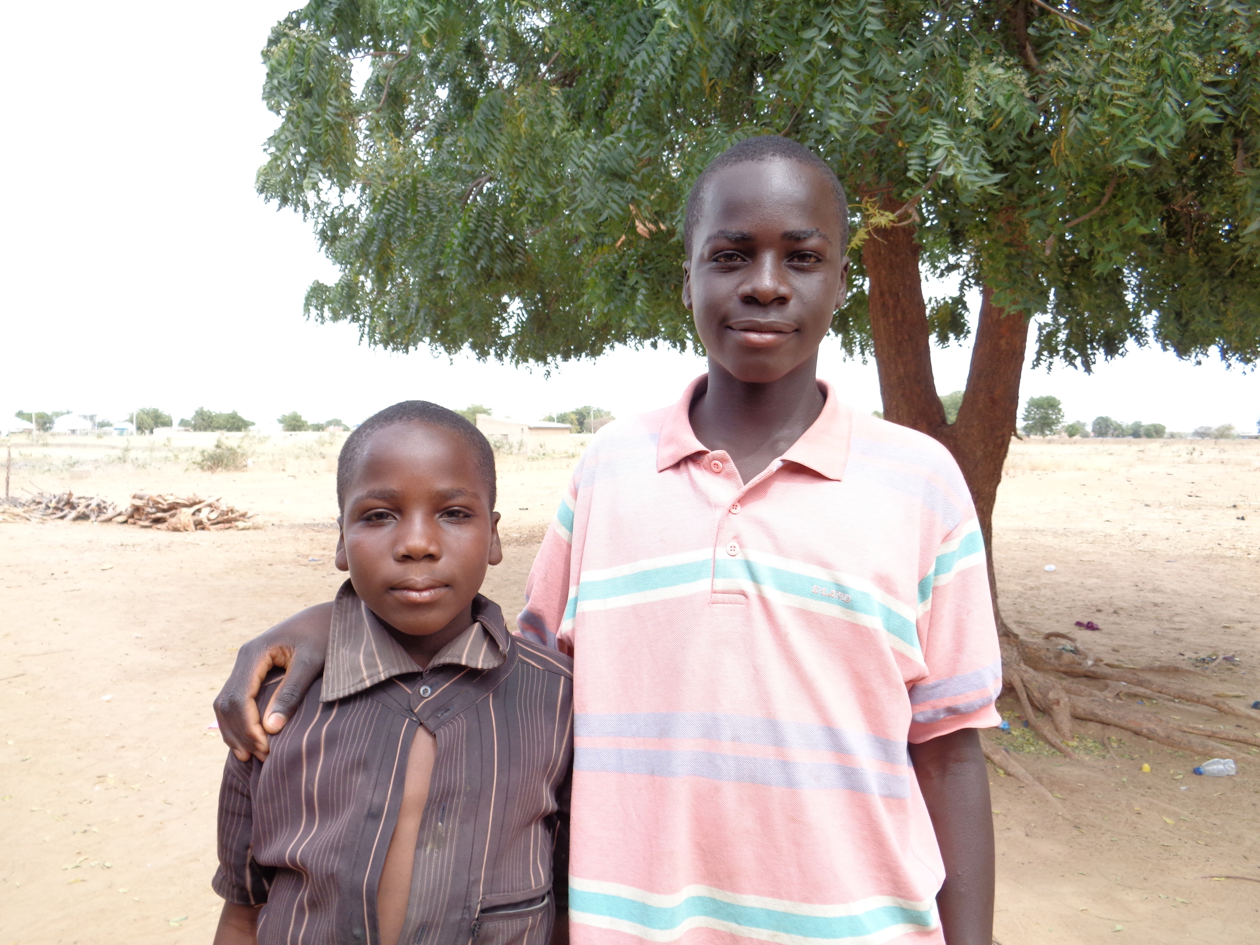 Friday (on the right) was just 15-years-old when Boko Haram attacked his village in November 2014. His older brother was killed, and he and his five younger siblings were forced to run for their lives. They are now living as IDPs with their aunt in Maiduguri.