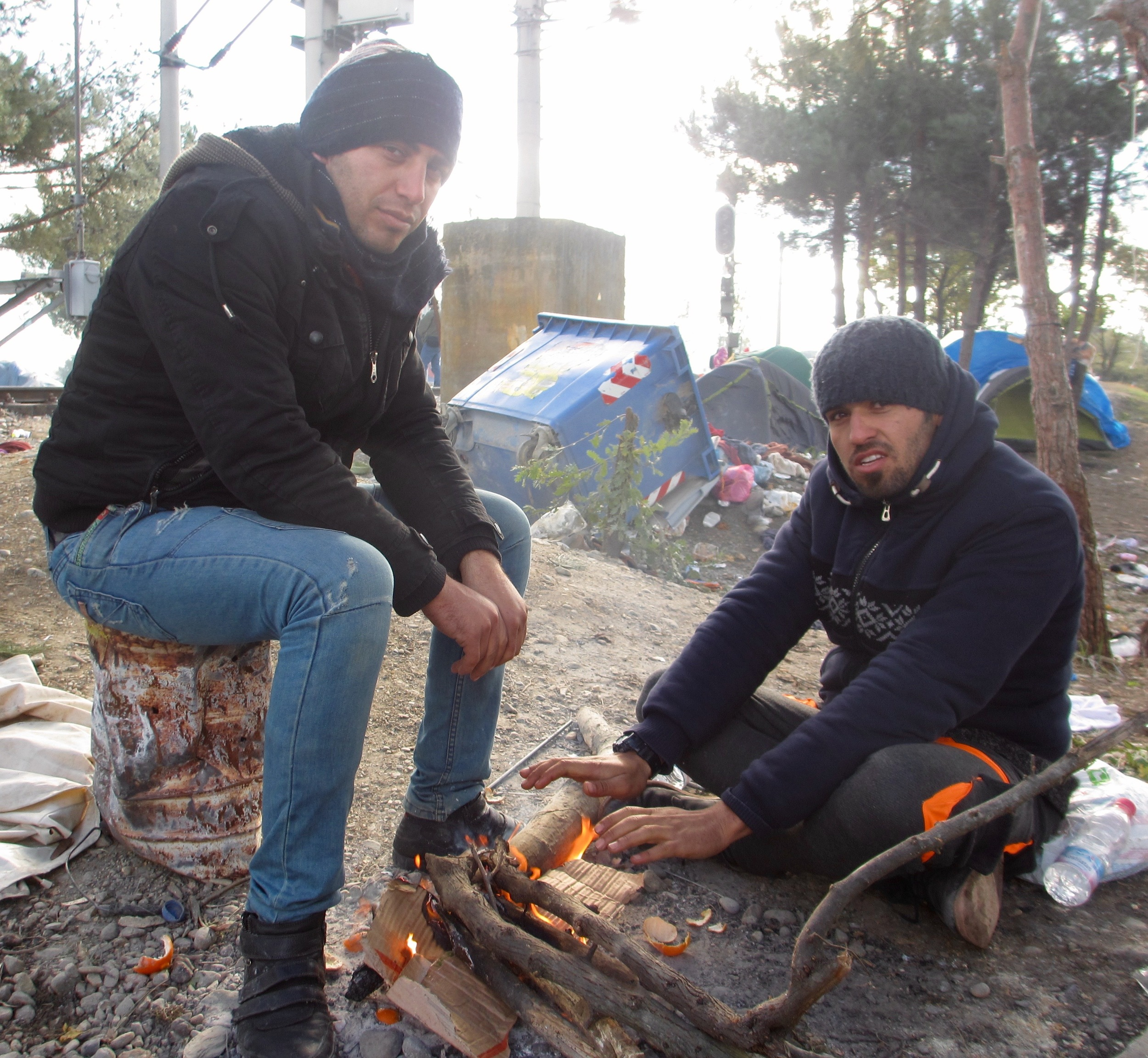 Two Iranian men make a fire at Idomeni transit camp on Greece's northern border with Macedonia.