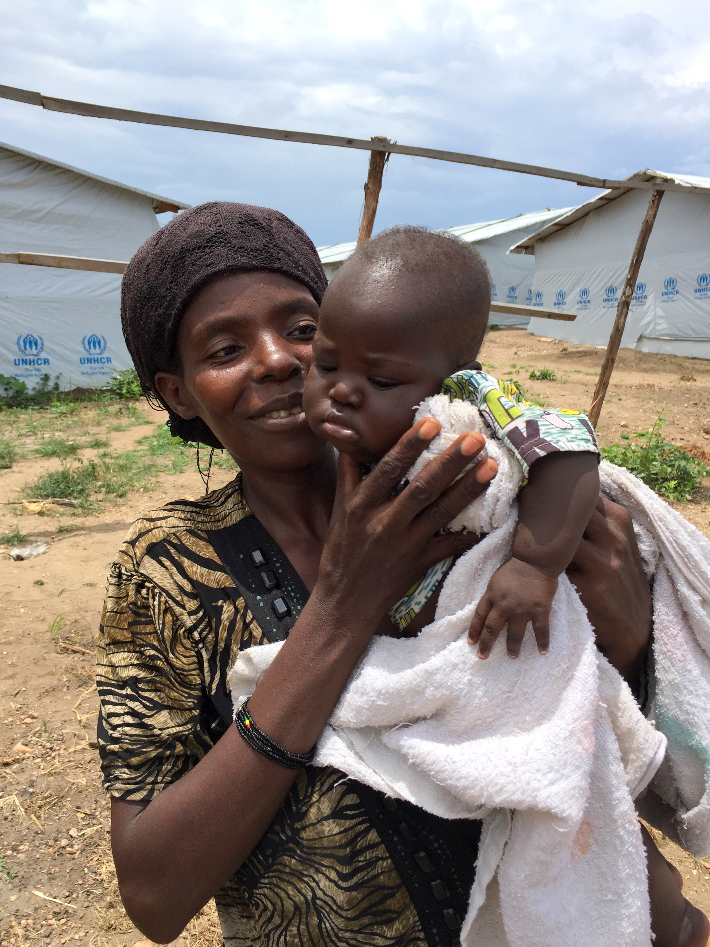 """But in Lusenda, """"comprehensive"""" does not mean sufficient. Refugees receive less than $0.50 a day to spend on food, and patients at the nearby clinic say they receive little more than painkillers."""