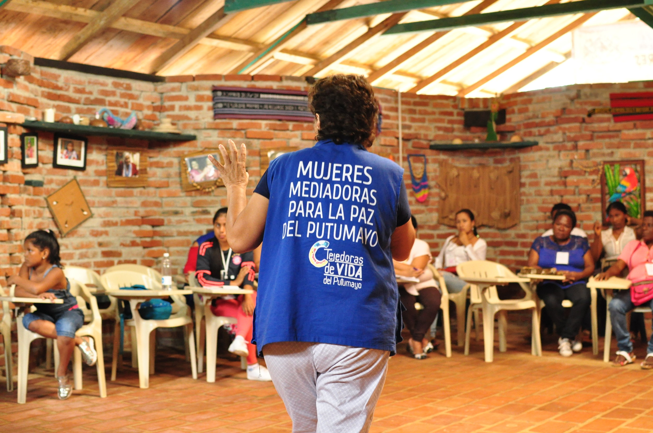 In the absence of a strong government effort to educate rural populations on the peace agreement, women's activists such as this one in Putumayo province, are traveling to remote areas throughout Colombia, oftentimes with their personal resources, to get the word out about the peace deal.