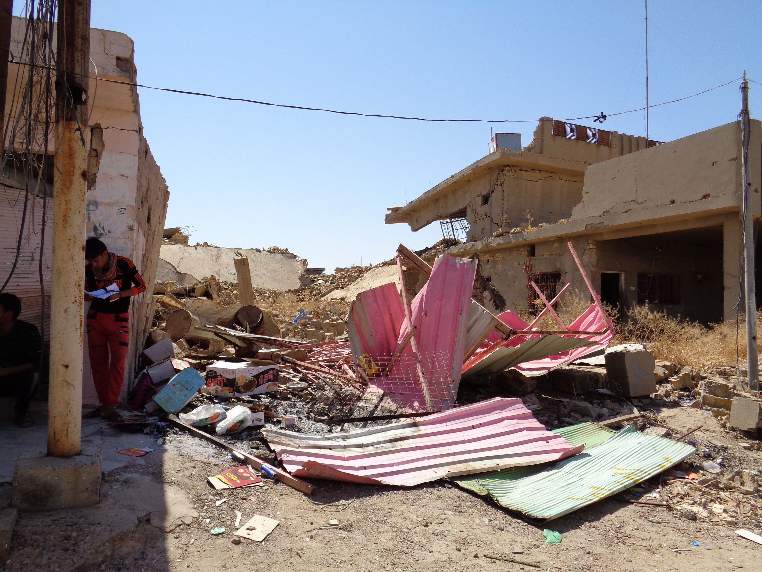 During ISIS's time in the town, airstrikes damaged scores of homes, businesses, and government buildings; others were burned, creating clouds of smoke to hide ISIS troops from aerial attack. RI met IDPs who were living in abandoned houses or shops because their homes were destroyed in the fighting.