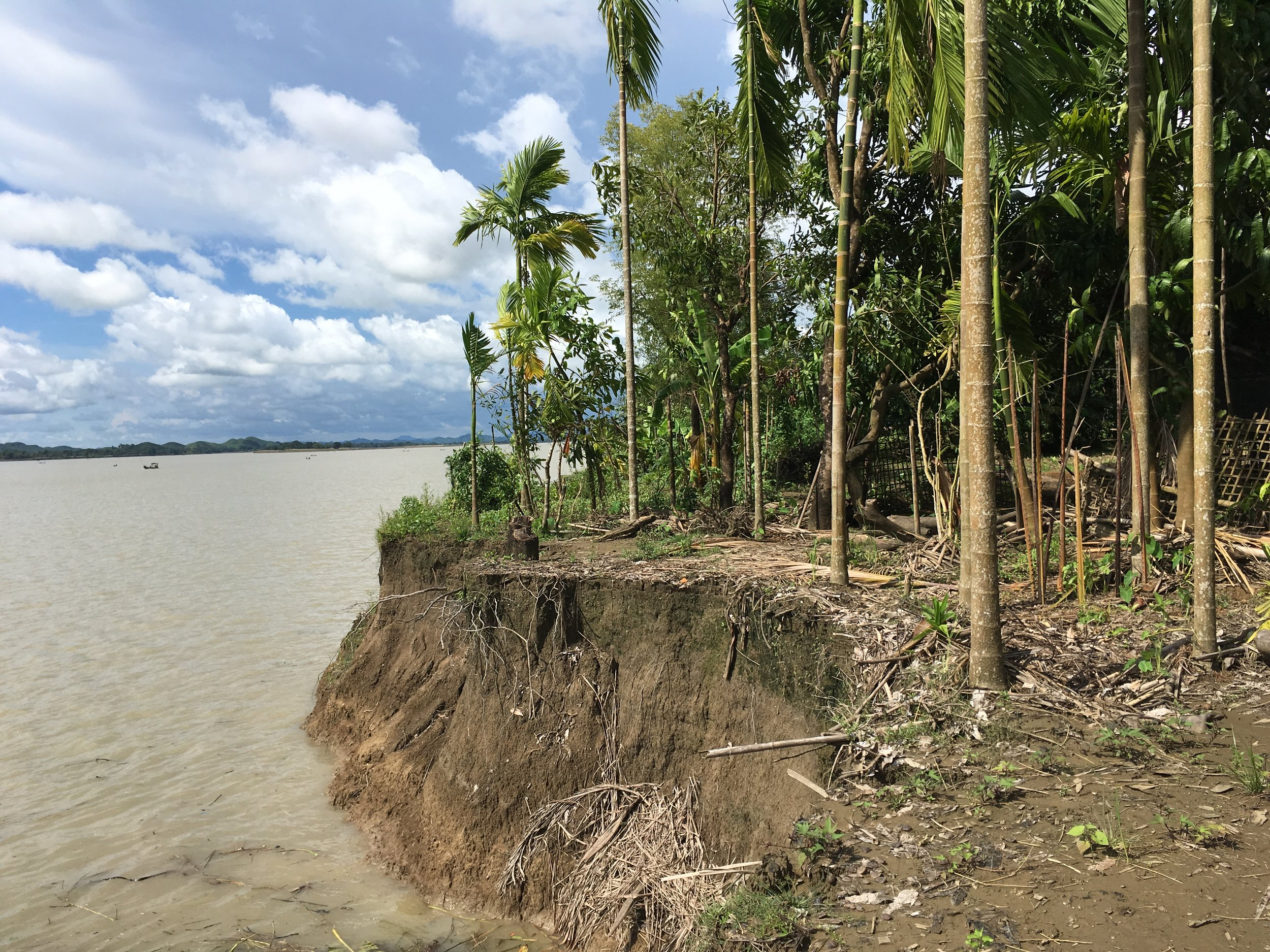 Before the 2015 floods and landslides, villagers living on the river bank in Hla Ta village in Mimbya, Rakhine State, used to grow crops and tend to a scattering of animals around their basic bamboo huts. The 2015 floods and landslides caused a 40-foot strip of land along the river bank to fall into the water, taking with it shelters, animals, and crops. Many villagers have now had to take out loans to feed their families. In the context where poor, rural villagers in Myanmar are often already heavily indebted, this is particularly concerning.