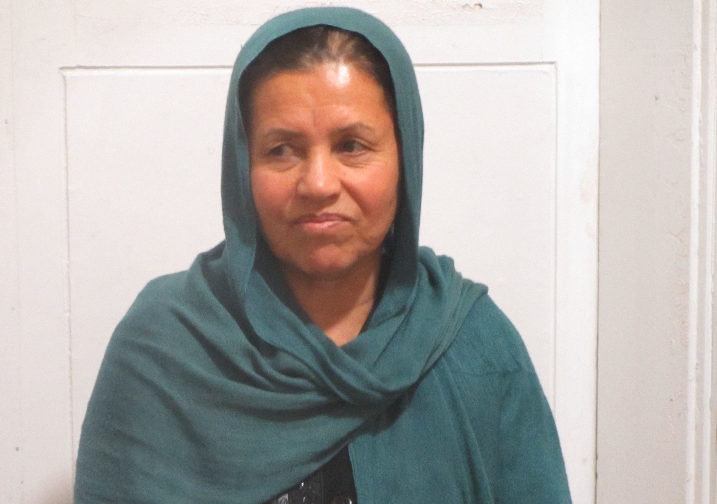 """""""Except God, we don't have anyone."""" The Afghan woman pictured here told RI about her feeling of isolation in Turkey and how she, like many refugees, carries traumatic experiences with her. She lost her husband and son in Afghanistan and told RI that now she sometimes sleeps in front of the door to their room feeling she must protect her remaining daughters."""