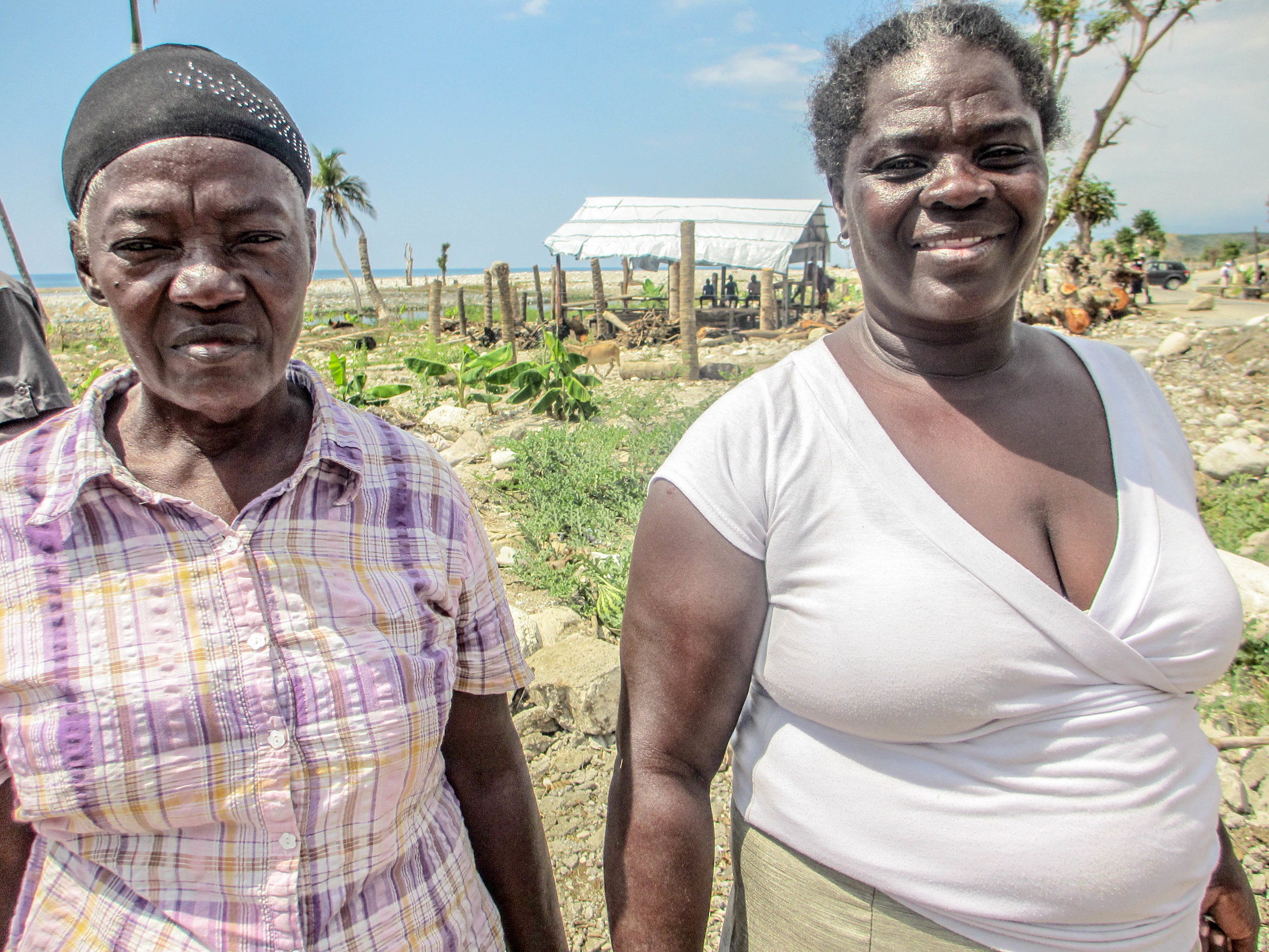 The homeless woman is now living with her sister, seen here. Many Haitian adults and children who lost their homes in the hurricane are relying on family and neighbors for shelter, sharing crowded living quarters. Host families are struggling to meet the added burden.