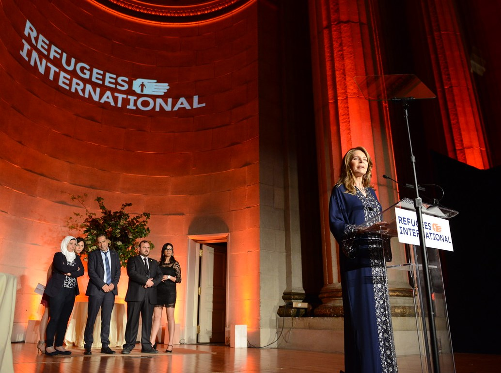 Her Majesty Queen Noor Al-Hussein of Jordan presents the McCall-Pierpaoli Award to the White Helmets.