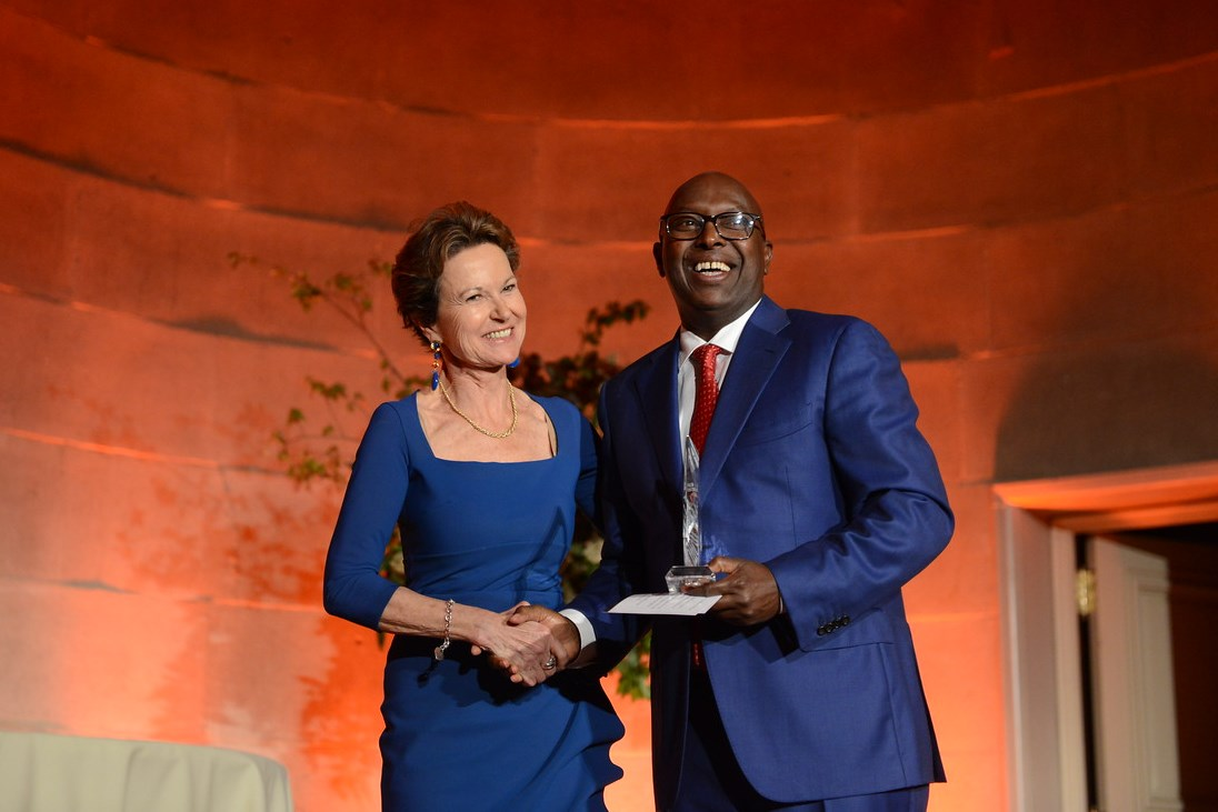 Kati Martin presents the Richard C. Holbrooke Leadership Award to Hassan Shire, Executive Director of the East and Horn of Africa Human Rights Defenders Project.