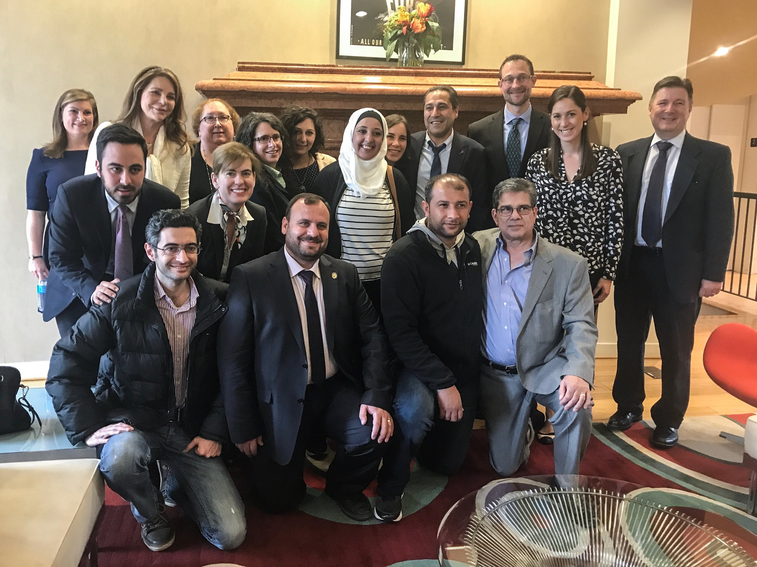 RI Staff and Board Member Queen Noor-Al Hussein with the White Helmets and staff of the Syria Campaign.