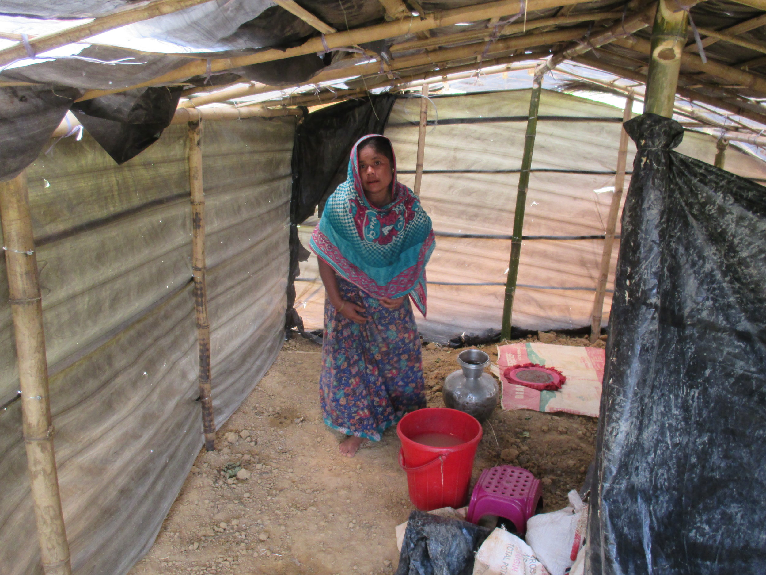 Halima*, 40, arrived at Kutupalong makeshift settlement with her five children just days before RI met with her. Neighbors helped her build this shelter, nearly uninhabitable during the extreme daytime heat and vulnerable to the heavy winds of the monsoon season.