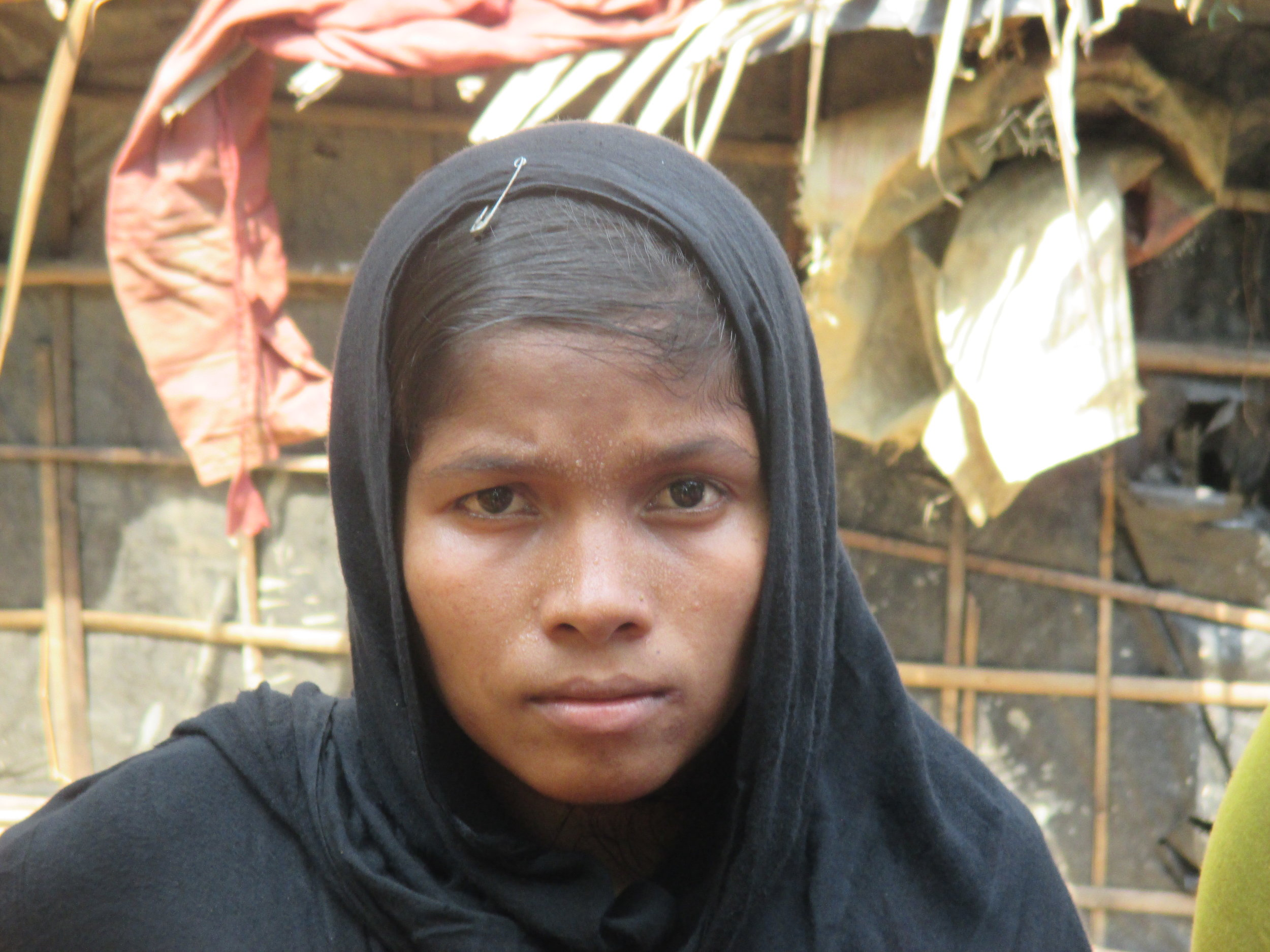 """For those Rohingya who fled since October, the memory of recent abuses is fresh. Farida*, 20, fled her village in Maungdaw five months ago. """"My neighbors were raped,"""" she said, """"As a young girl, I worried too much. I did not feel safe to stay."""""""