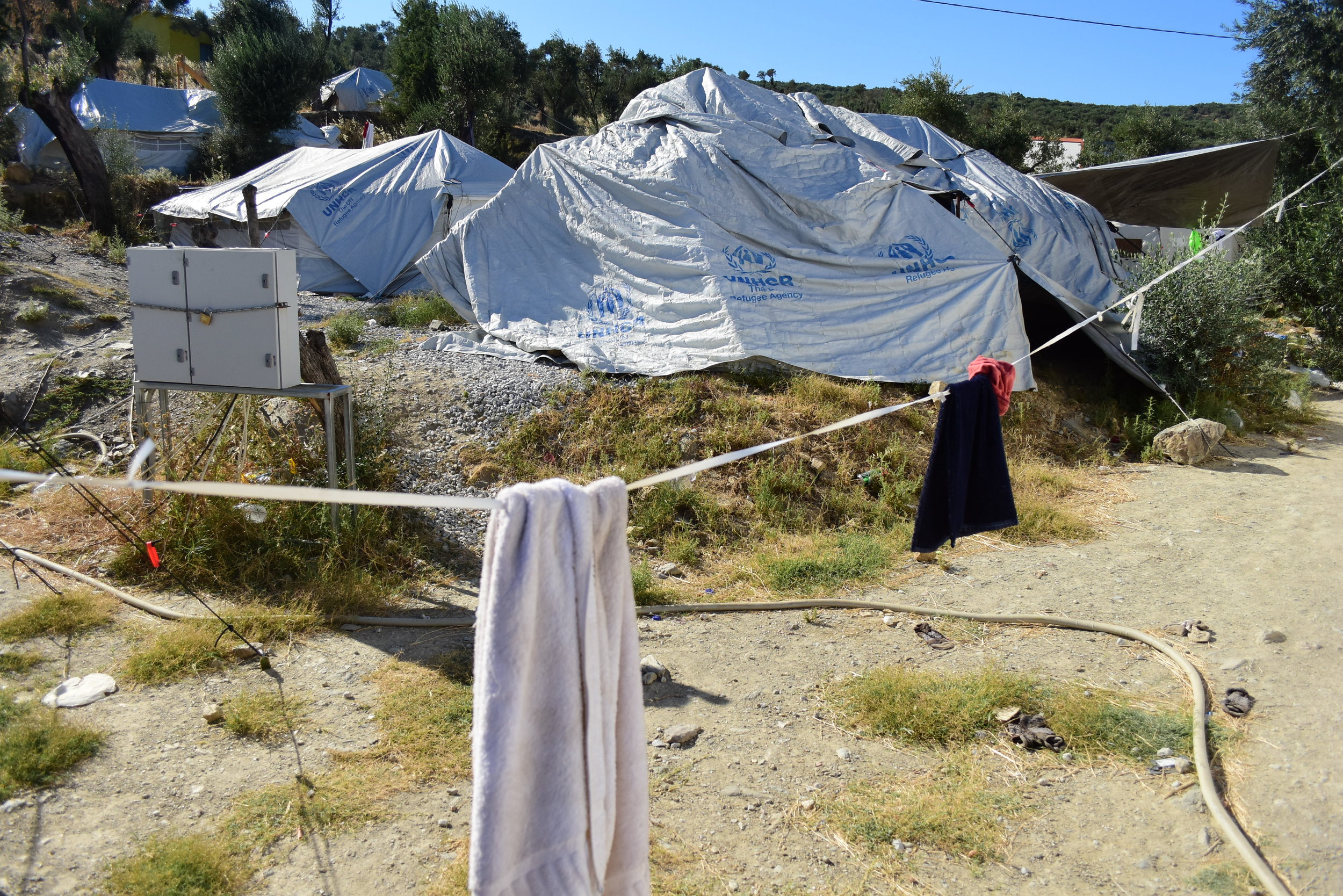 """An impromptu, overflow site hosting dozens of refugees outside Moria, the """"hotspot"""" camp on the island of Lesvos. In this site, people complained of snakes entering their tents."""