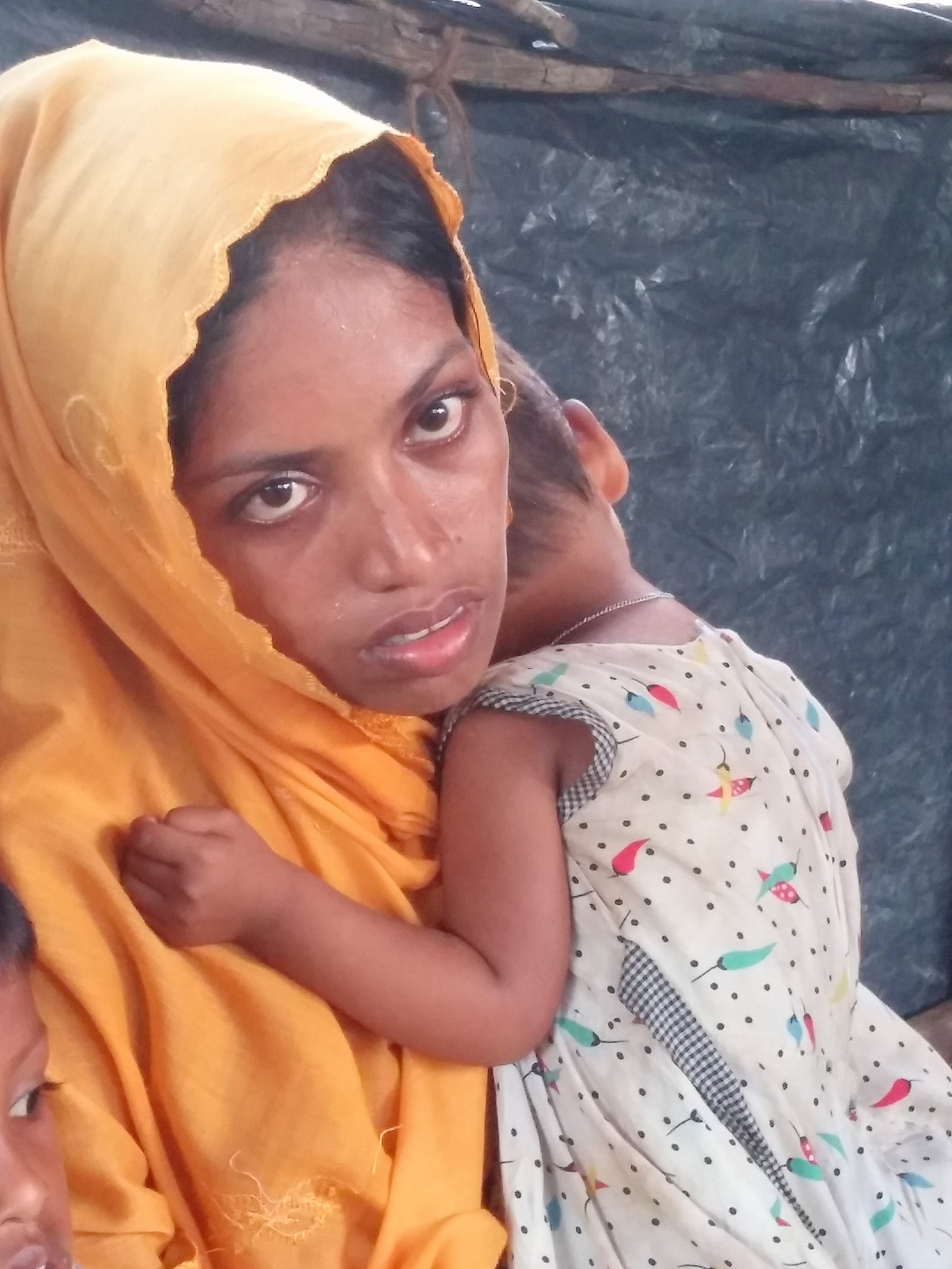 This mother told RI that the Myanmar army attacked her village and shot her husband. She escaped with her three daughters by hiding in water and walking for days to reach Bangladesh.
