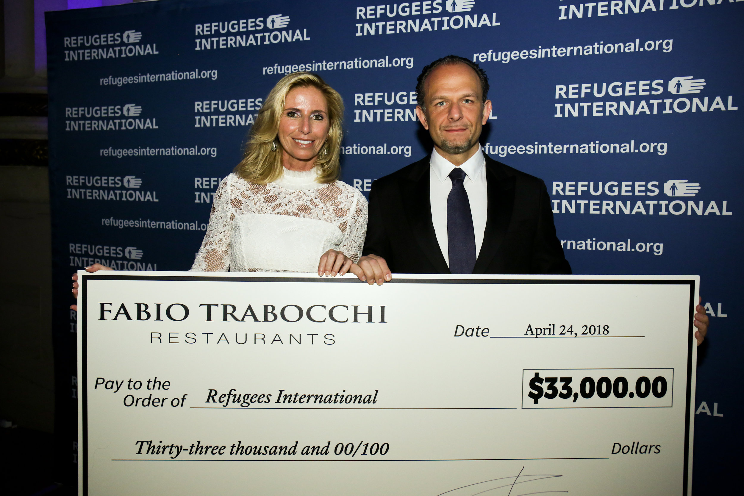 Maria and Fabio Trabocchi present their generous gift to Refugees International