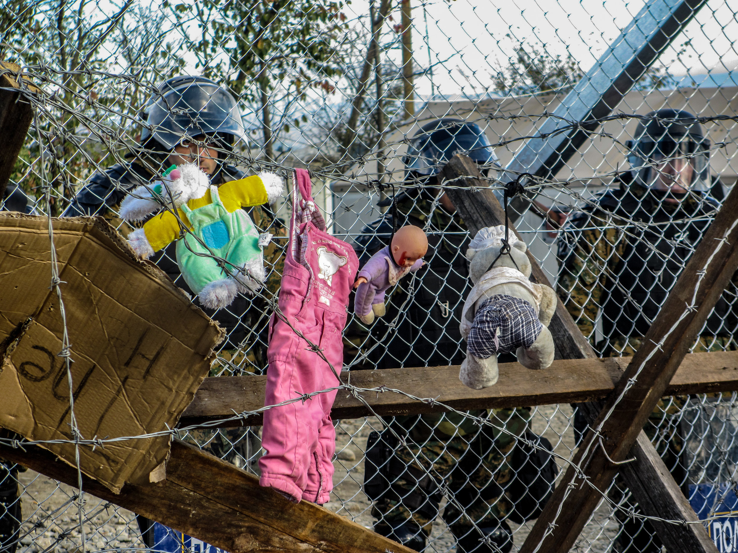 Toys left behind by children at border crossing in Greece.