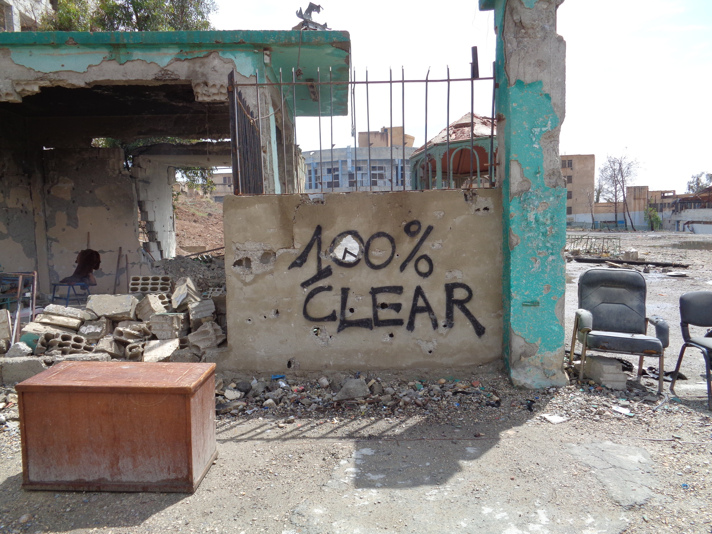 Sign noting one building in Raqqa city cleared of explosive devices.