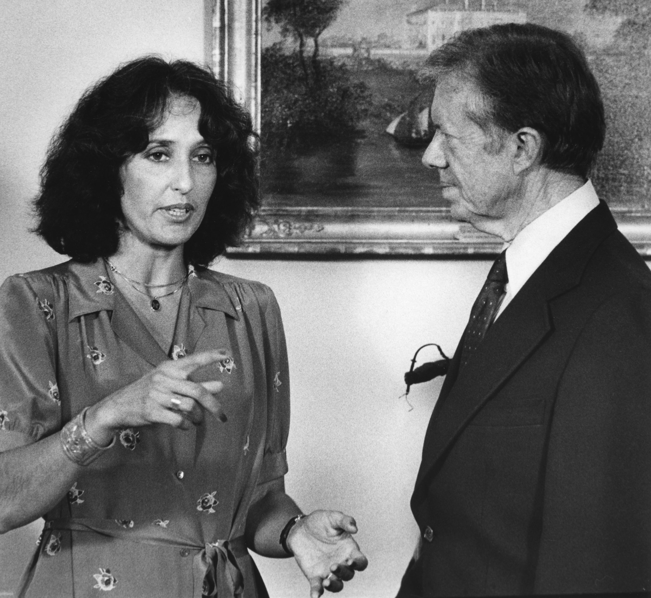 President Carter talks with singer Joan Baez in the Oval Office of the White House in Washington in 1979. Baez just returned from a fact-finding trip in Southeast Asia. (UPI Photo/Frank Cancellare/Files)