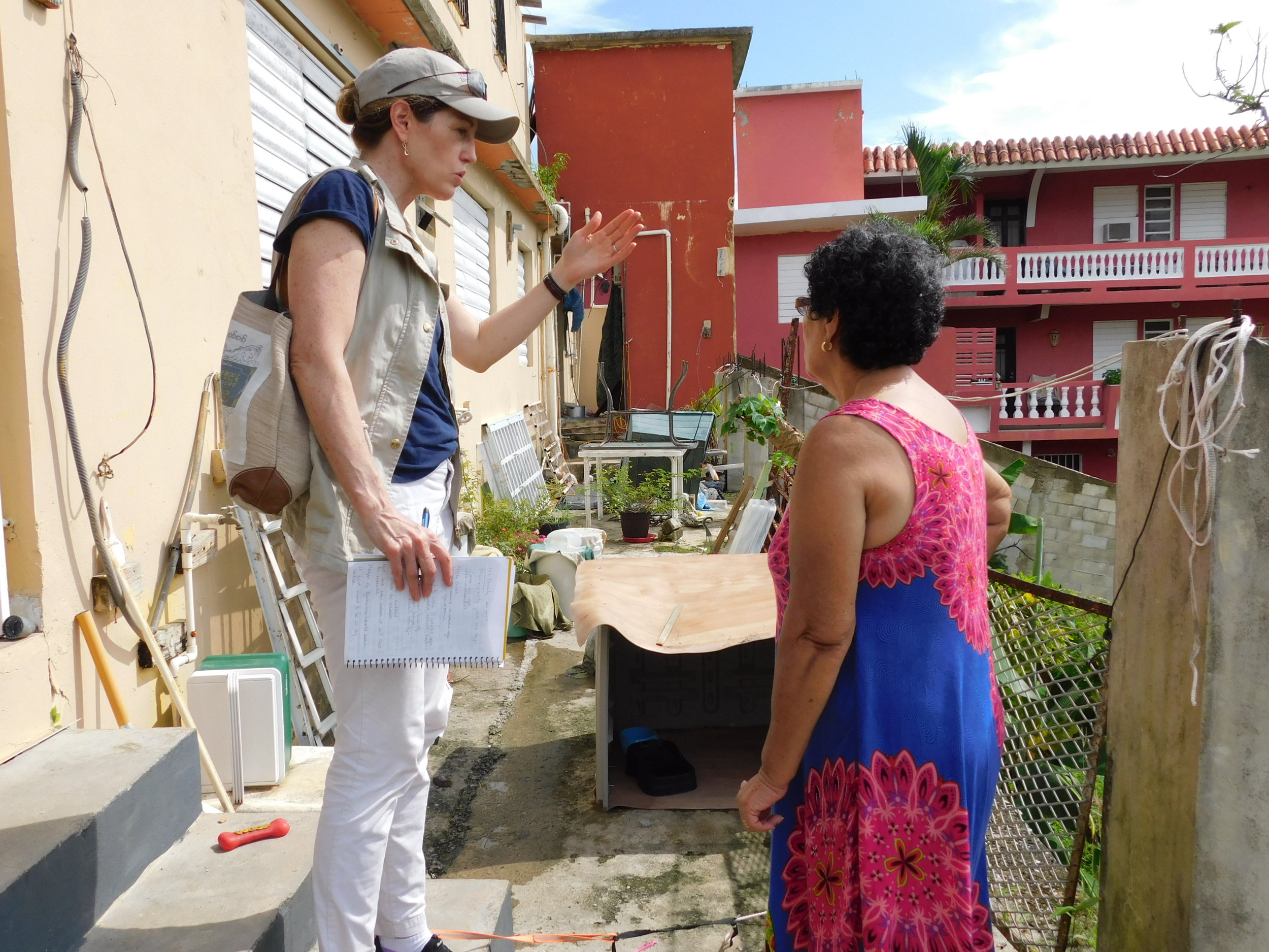 Alice Thomas, RI's Climate Displacement Program Manager, speaks to a woman in Puerto Rico after Hurricane Maria struck her island.