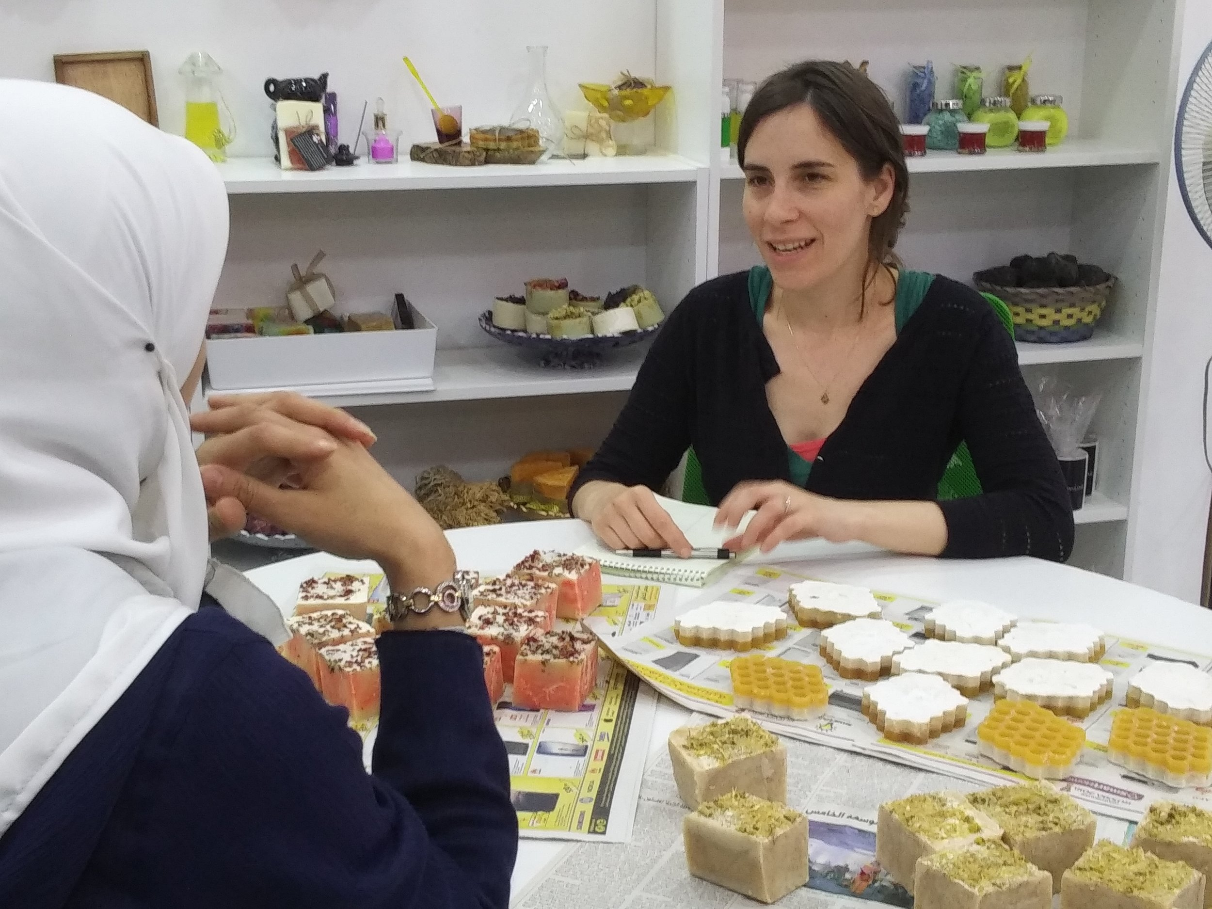 Izza Leghtas (right) interviewing Syrian handicrafts entrepreneur in Amman, Jordan.