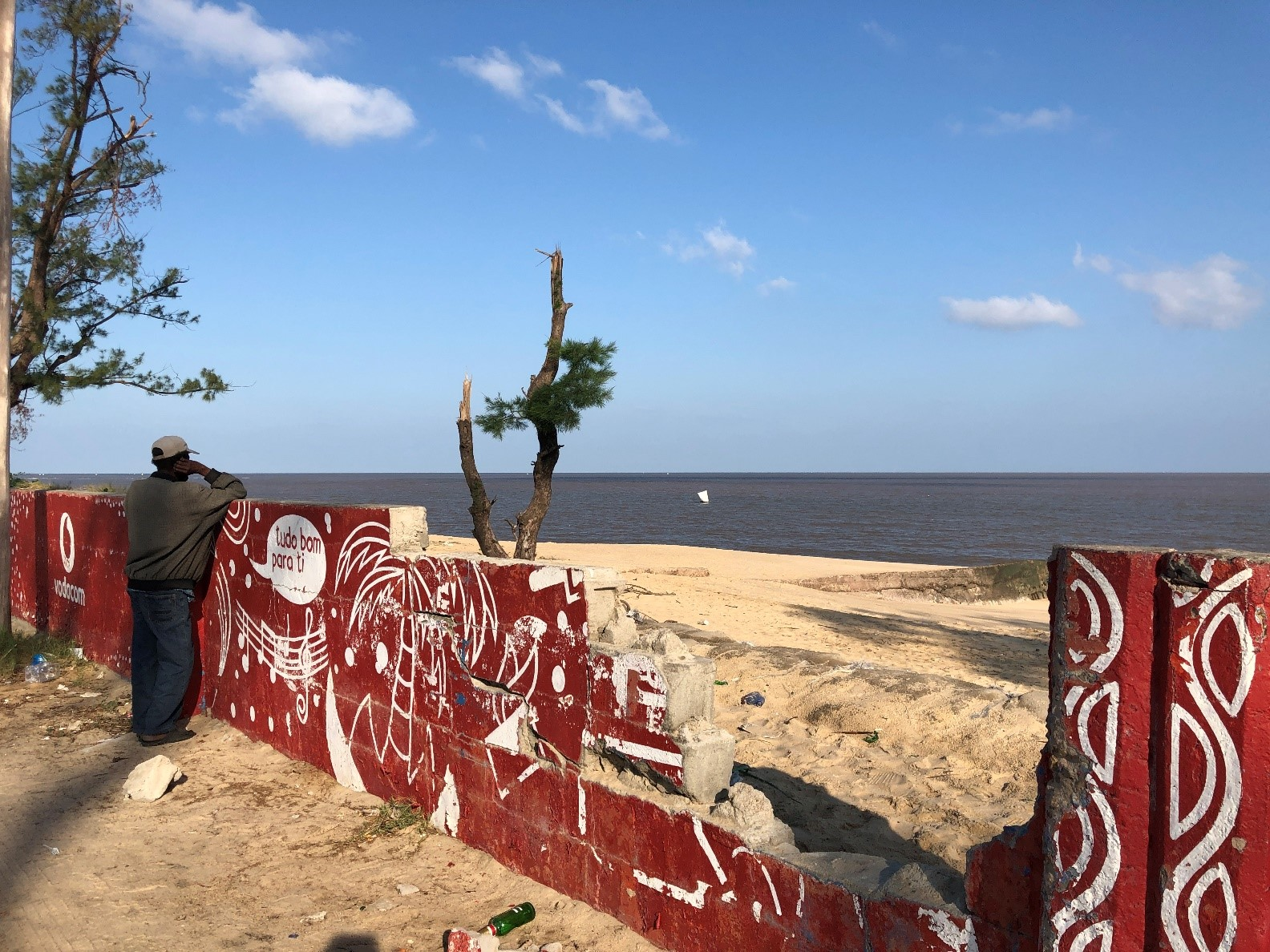 A man looks out at a damaged beach in Beira, Mozambique. A city of more than half a million people and the capital of Mozambique's Sofala Province, Beira was in the direct path of Cyclone Idai.