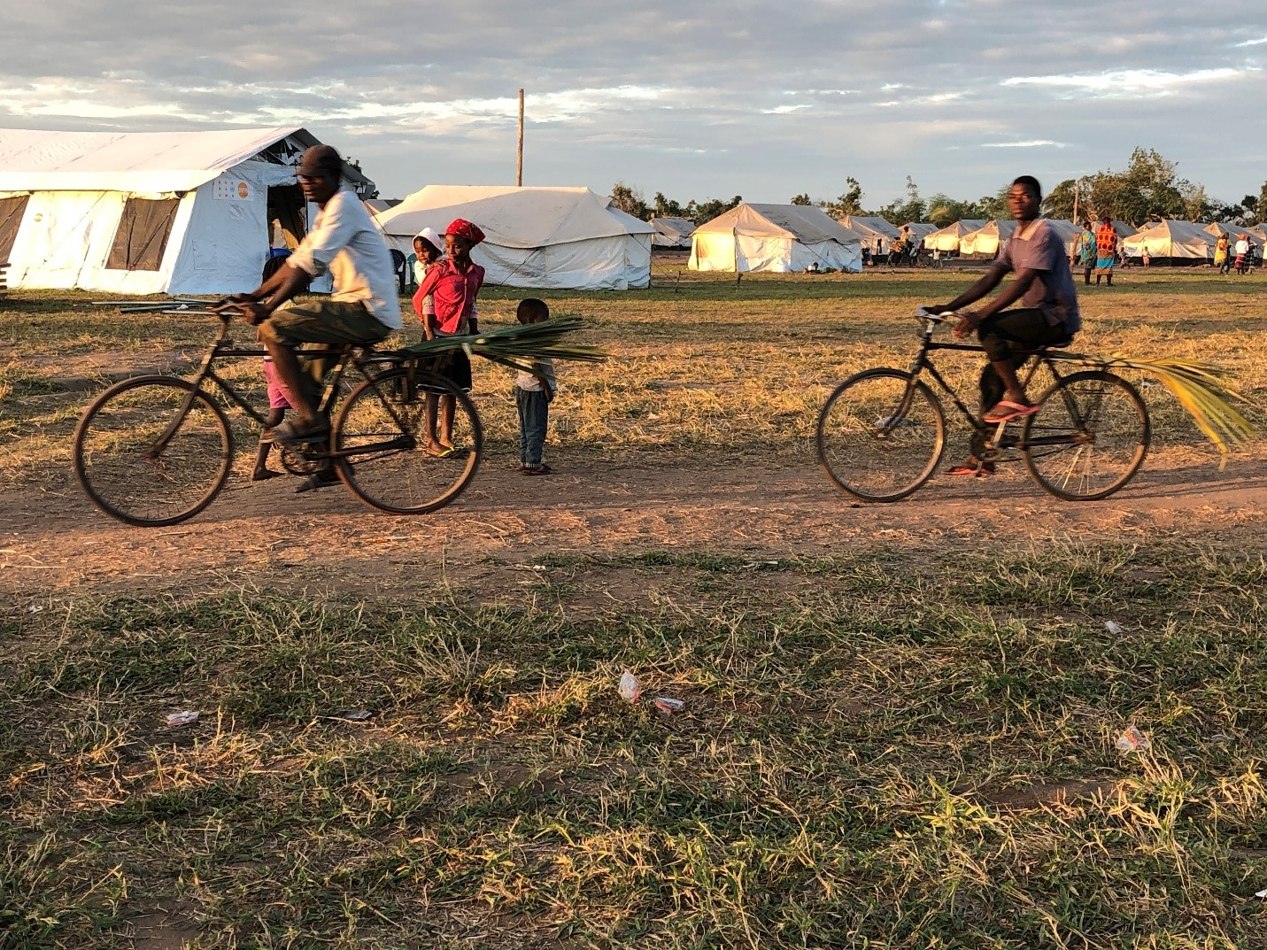 Bicyclists in the Guara Guara temporary accommodation site in central Mozambique.