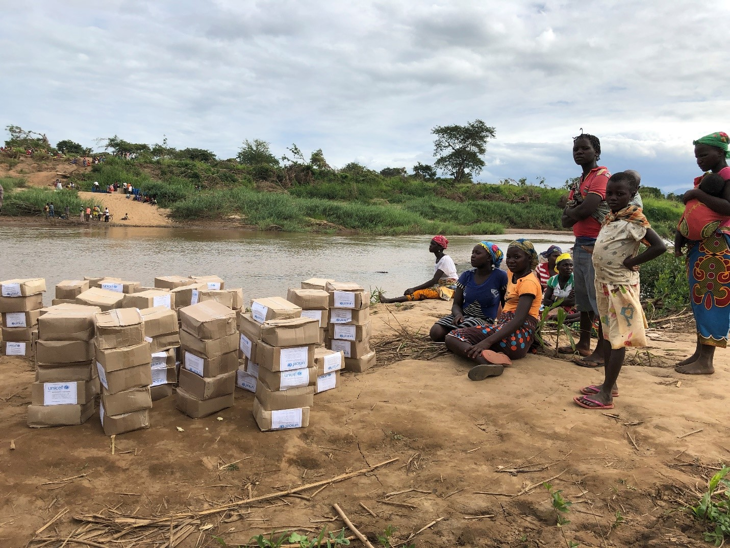 """Distribution of """"dignity kits"""" in central Mozambique. Dignity kits consist of underwear, sanitary pads, and soap for women and girls."""