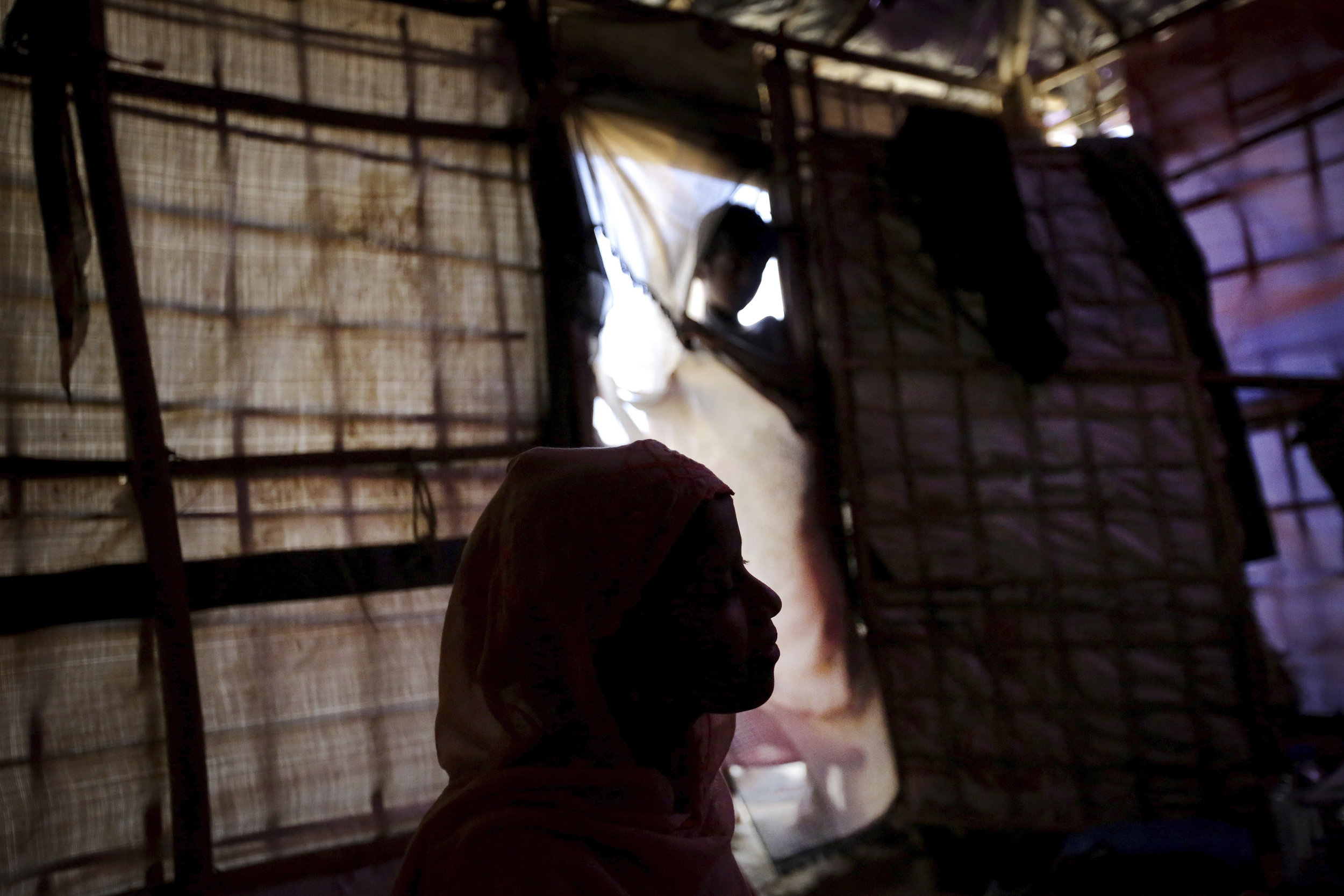 R, a 13 year-old Rohingya girl, is seen in silhouette in her tent in Kutupalong refugee camp in Bangladesh. Photo Credit: Wong Maye-E/AP Photo.