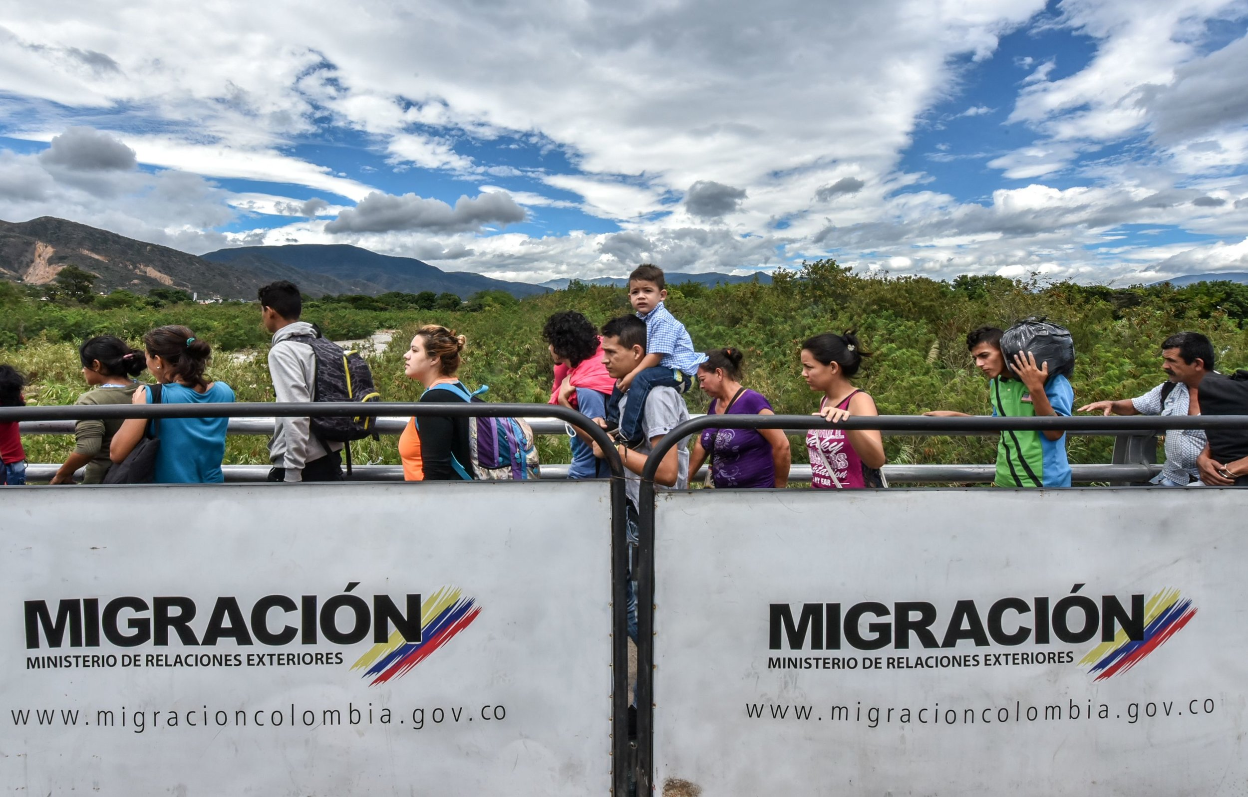 Venezuelans cross the Simon Bolivar international bridge from Venezuela to Colombia. Photo Credit: LUIS ACOSTA/AFP/Getty Images.
