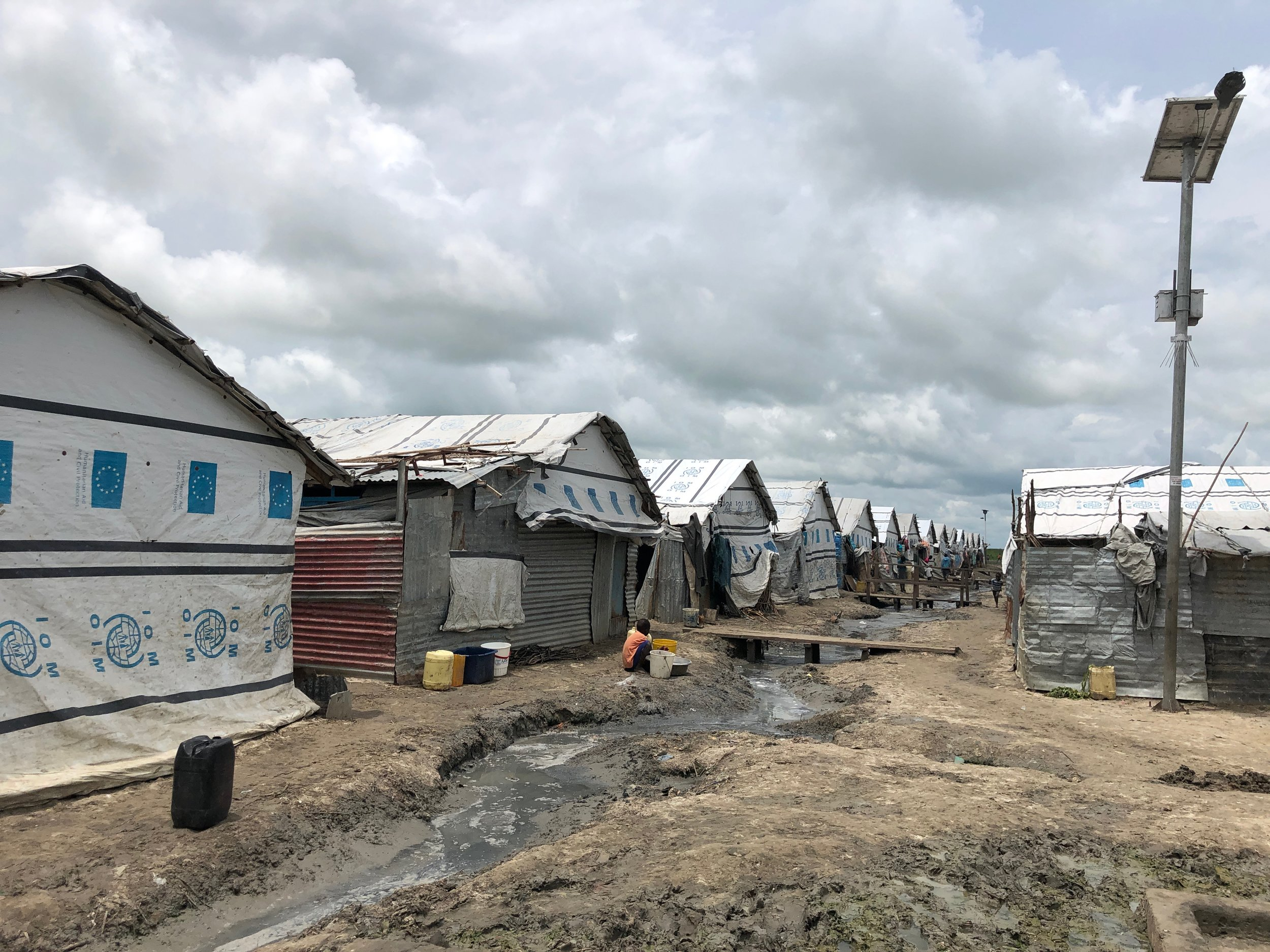 Although there are some services within the Malakal POC, the conditions are still challenging. Sanitation is a problem and when heavy rains come, people have to wade over raw sewage