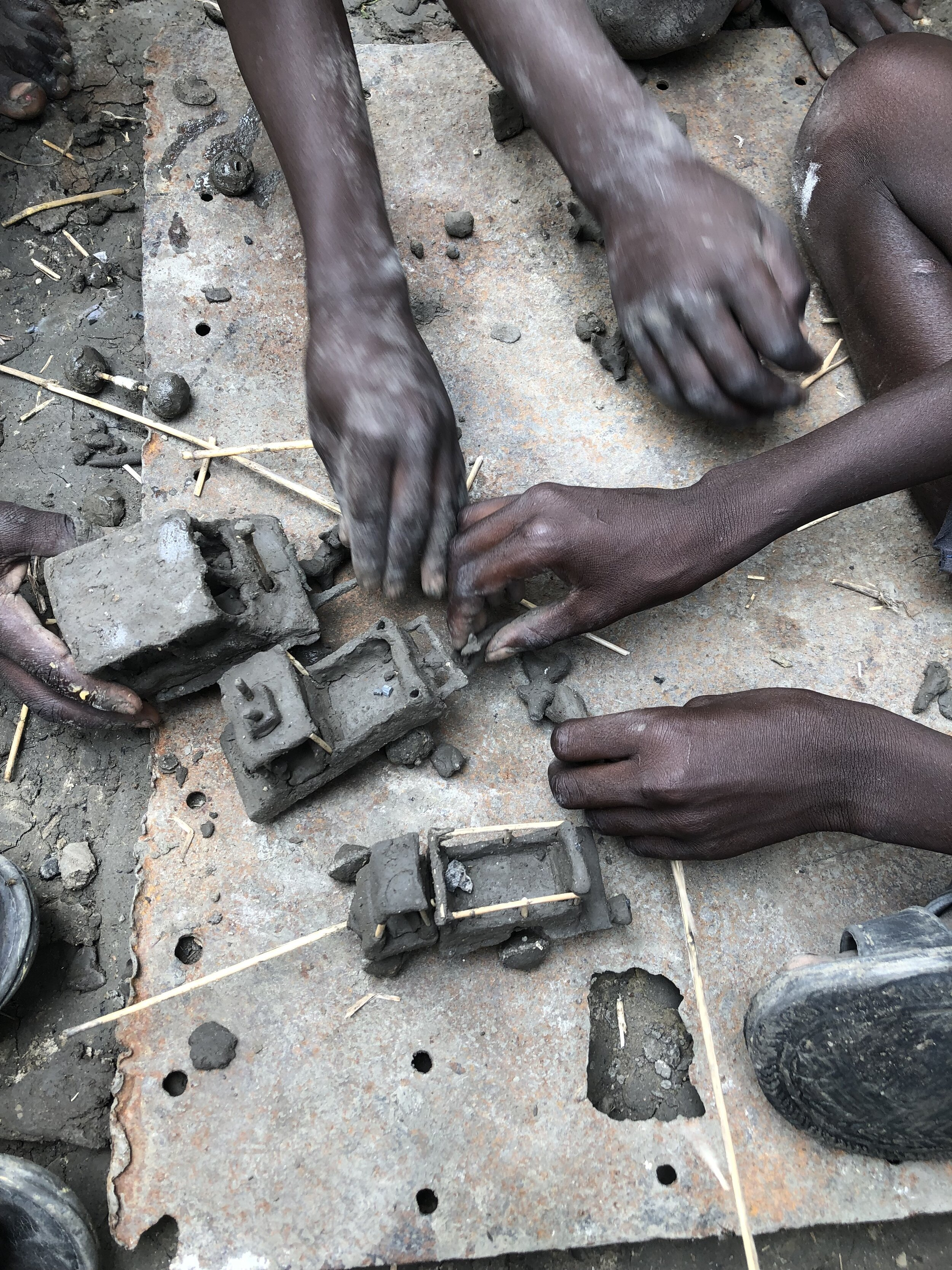 War and displacement has disrupted the education of many South Sudanese children. These boys pass the time in the Malakal POC.