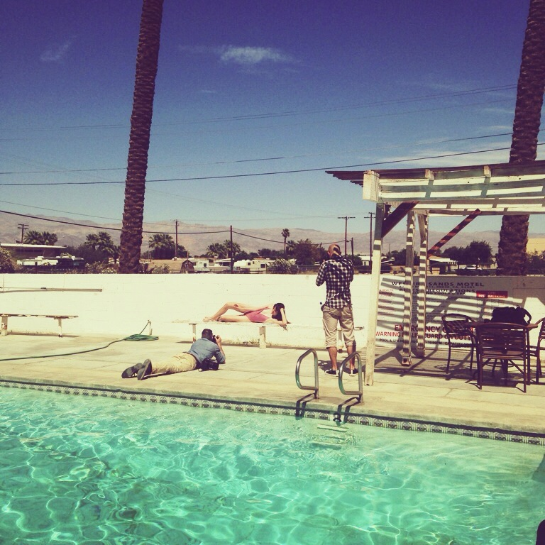 Some of the guys shooting with Zoe by the pool.