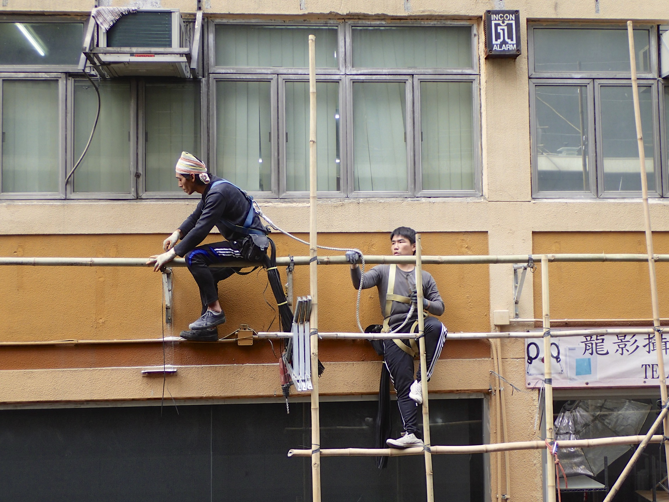 Construction workers in Wanchai.I love the practical spirit in Hong Kong. Though this one looks a bit unstable, it is perfectly save. Perhaps.