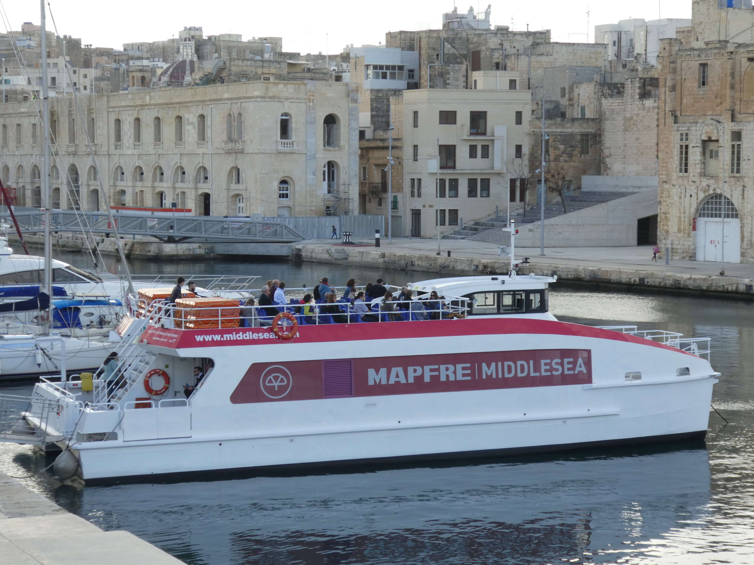 Less than 5 minutes more walk: The ferry between Cospicua (the Three Cities) and Valletta Waterfront leaves every full and half hour and takes 15 minutes to Valletta.