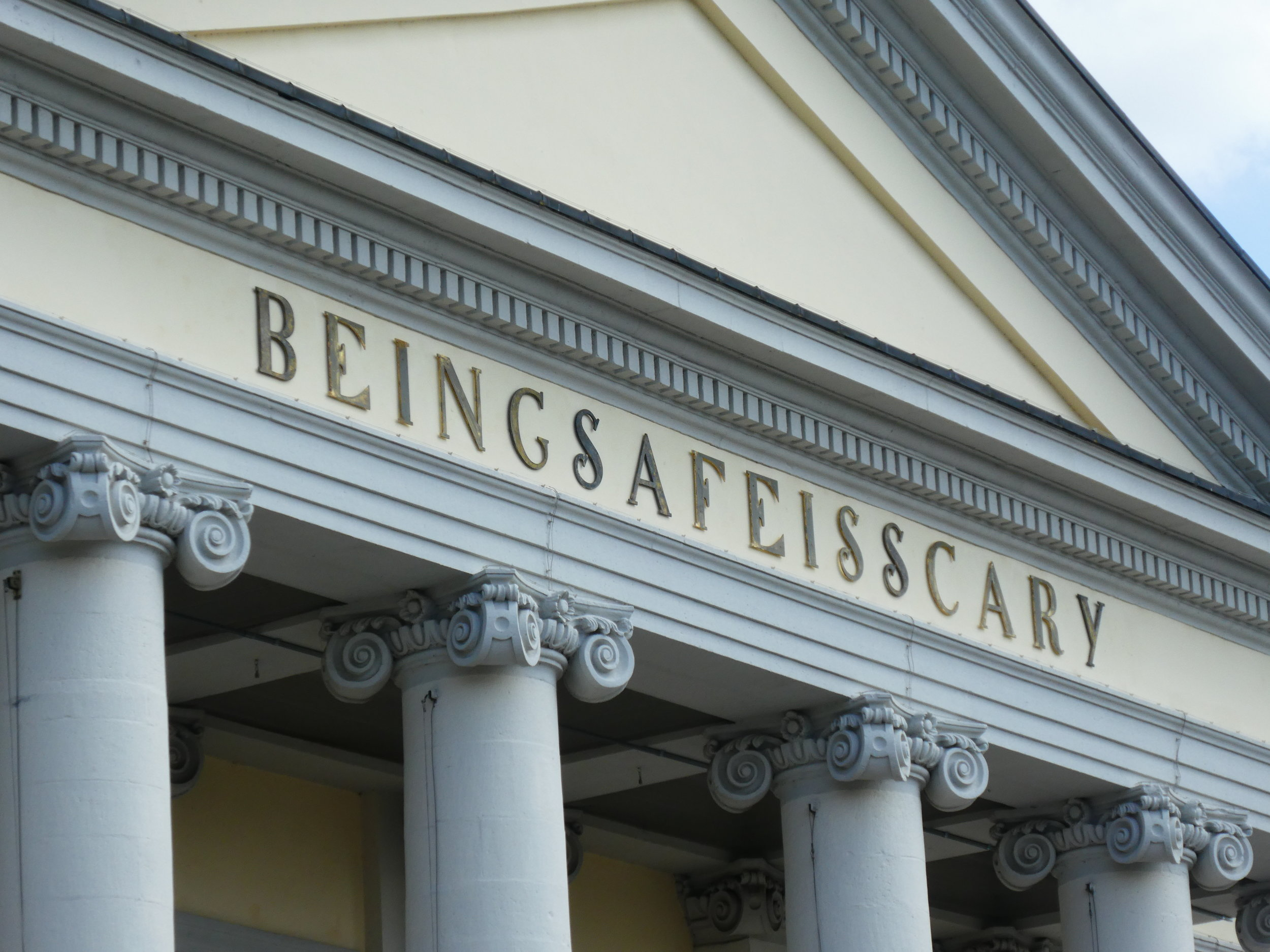 The Kassel Fridericianum crowned by the letters BEINGSAFEISSCARY