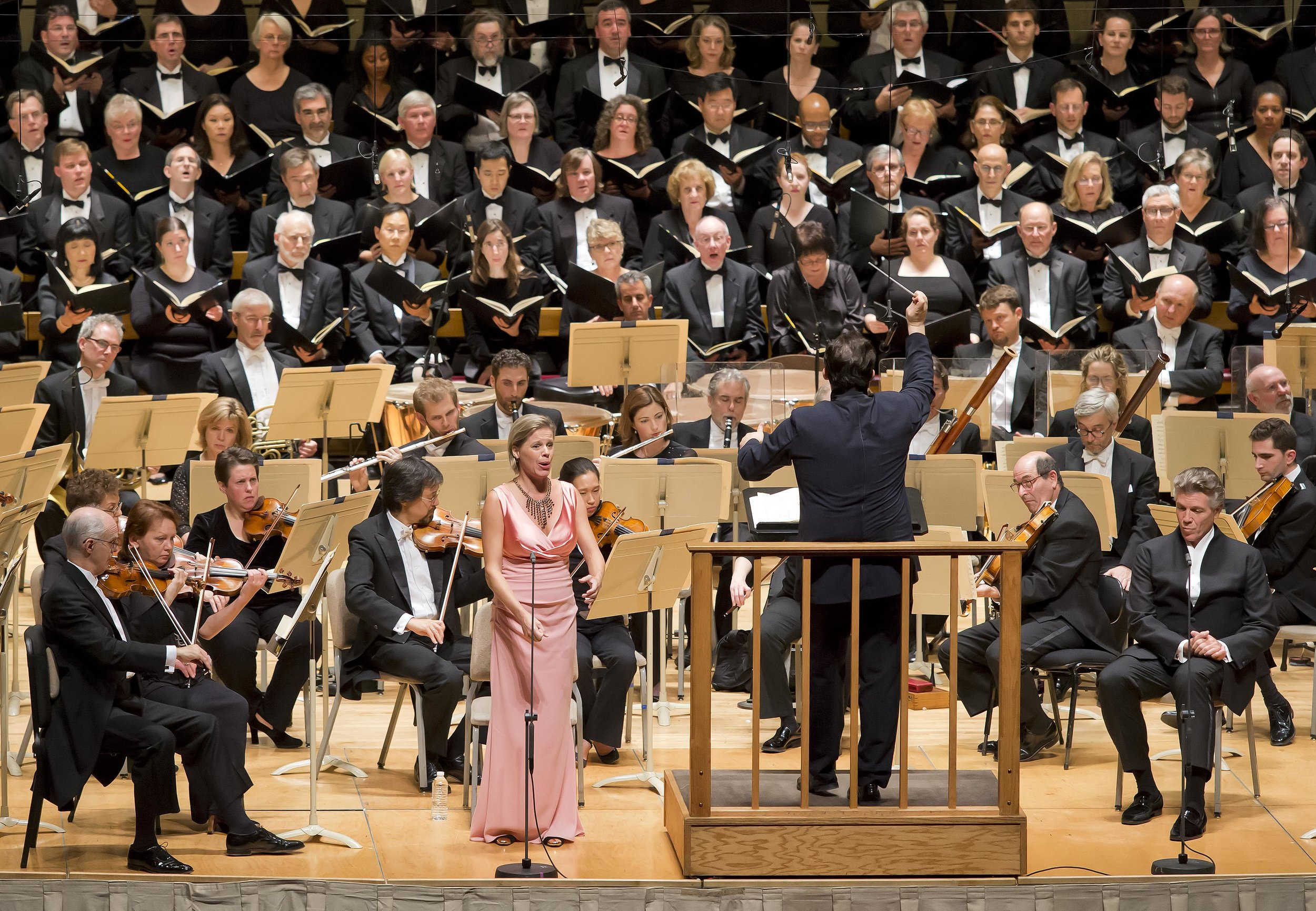 Soprano Camilla Tilling, with music director Andris Nelsons and the Boston Symphony Orchestra, performing Brahms' Ein Deutsches Requiem. Winslow Townson photograph.