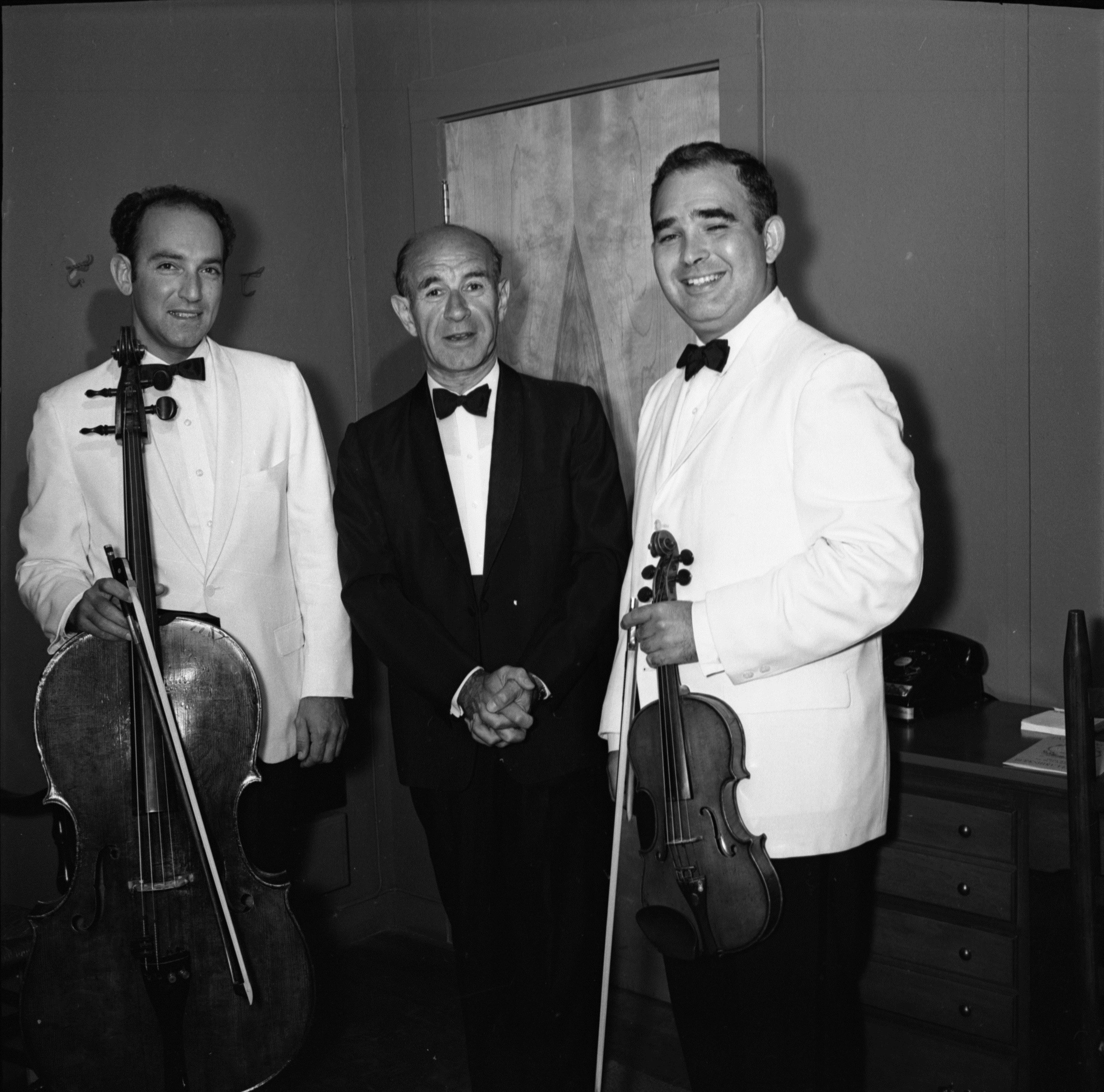 Jules Eskin (left), backstage at Symphony Hall with Erich Leinsdorf (center) and Joseph Silverstein. Year unknown. Whitestone photograph.