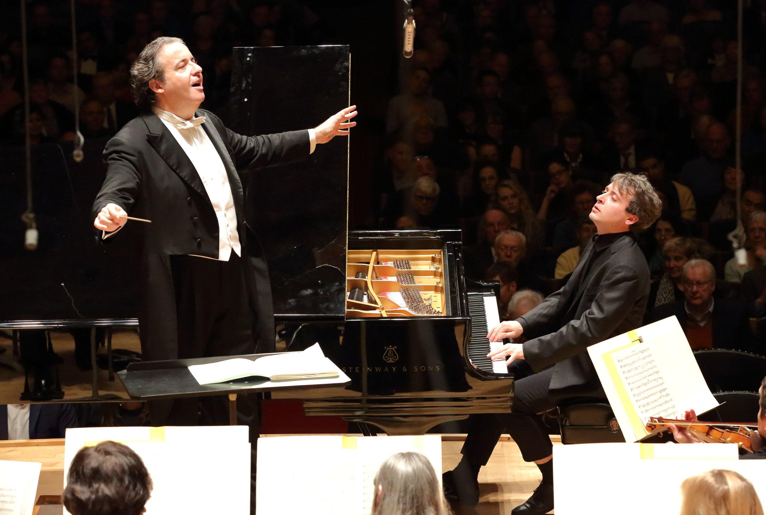 Juanjo Mena conducts the Boston Symphony Orchestra with pianist Jean-Frédéric Neuburger, Thursday, Jan. 26 at Symphony Hall. Hilary Scott photograph.